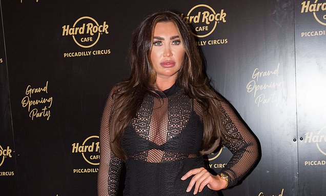 Lauren Goodger parades her jaw-dropping curves in a risqué black sheer catsuit