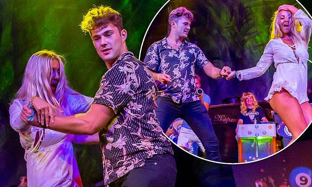 Love Island's Curtis Pritchard dances a racy Cha Cha Cha with blonde woman on stage in Mallorca